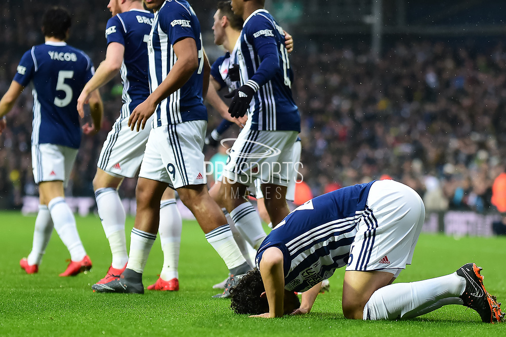 West Bromwich Albion defender (on loan from Al Ahly) Ahmed Hegazi (26) scores a goal and celebrates 1-0 by kissing the turfduring the Premier League match between West Bromwich Albion and Southampton at The Hawthorns, West Bromwich, England on 3 February 2018. Picture by Dennis Goodwin.