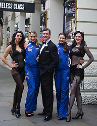 "© Licensed to London News Pictures. 30/06/2012. London, England. L-R: Djalenga Scott, Jenna Randall, Robin Cousins, Olivia Federici and Lauren Brooks. Olympic Gold Medallist Robin Cousins poses with Jenna Randall and Olivia Federici from Team GB's Synchronised Swimming Team, whom he mentors, and dancers from the musical Chicago. Robin Cousins will take up the role of ""Billy Flynn"" in the musical Chicaco at the Garrick Theatre from 17 July 2012 for a limited season. Photo credit: Bettina Strenske/LNP"
