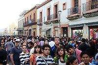 Long lines of people wait for their turn to view the displays at Oaxaca's Noche de Rabanos / Night of the Radishes festival.