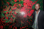 VENICE, ITALY..50th Biennale of Venice.British Pavillion..Chris Ofili with one of his works..(Photo by Heimo Aga)