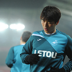 Sung-Yueng Ki of Swansea City warms up prior to Swansea City vs Arsenal, Premier League, 30.01.18 (c) Harriet Lander | SportPix.org.uk