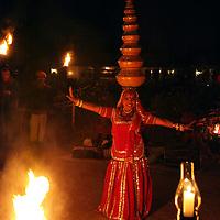 Asia, India, Jaipur. Balancing dance performance at Dera Amer.