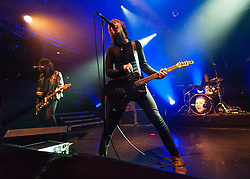 © Licensed to London News Pictures. 07/11/2014. London, UK.   Catfish and the Bottlemen performing live at KOKO .   In this picture - Ryan Van McCann (centre), Johnny Bond (left), Bob Hall (right).  Catfish and the Battlement are composed of members Ryan Van McCann (Lead vocals, Rhythm guitar), Johnny 'Bondy' Bond (Lead Guitar), Benji Blakeway (Bass Guitar), Bob Hall – (Drums).  Photo credit : Richard Isaac/LNP