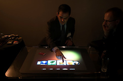 """HANNOVER, GERMANY - MARCH-6-2008 -  Microsoft gave a select few a private demonstration of """"Surface"""", their new coffee table PC. Currently surface is being aimed at the retail market and has a price tag around $10,000. It features touch screen technology that can sense and process multiple touches at the same time and """"turns an ordinary table top into a vibrant interactive surface"""". According to their literature, """"It features a 30 inch display in a table-like form factor that is easy for individuals and small groups to interact with in a way that feels familiar. Surface can simultaneously recognize  dozens and dozens of movements, such as touch, gestures and unique objects that that have ID tags similar to bar codes. Users can actually grab digital information with their hands and interact with content through touch and gesture without the use of a mouse or keyboard."""" At the moment it is only available to their select partners in the U.S. but they are feeling out the interest in Europe. Although they would not commit to a time frame for availability in Europe - sometime in 2008 is a possibility. (Photo © Jock Fistick)"""