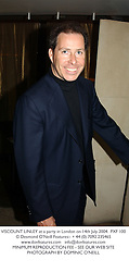 VISCOUNT LINLEY at a party in London on 14th July 2004.PXF 100