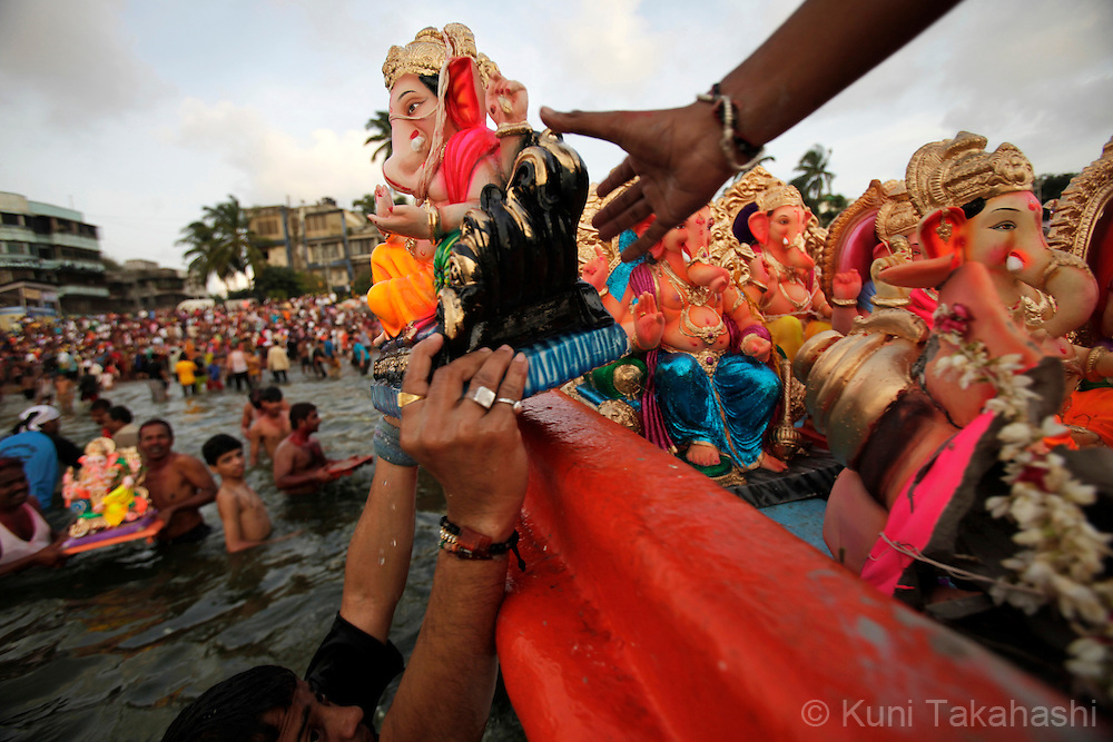 Hindu devotees load ganesha idols to a boat for immersing them into the sea in Mumbai, India on Sep 16, 2010 on the 6th day of Ganpati festival. The 10-day hindu festival, celebrating the birthday of Lord Ganesha who is widely worshiped as the god of wisdom, prosperity and good fortune, attracts tens of thousands people..Photo by Kuni Takahashi