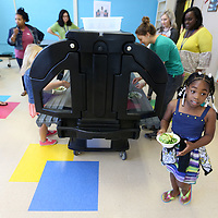 Maliyah Smith, 8, a second grader at Joyner Elementary School, walks to the lunch room with her salad after making a stop by the school's new salad bar during lunch on Tuesday. The Joyner salad bar (funded by a grant) is part of a larger effort by the Tupelo Public School District to make healty Habits part of students everyday lives.