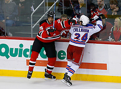 April 9, 2008; Newark, NJ, USA;  New Jersey Devils defenseman Johnny Oduya (29) hits New York Rangers right wing Ryan Callahan (24) during the first period of game 1 of the Eastern Conference Quarterfinal playoffs at the Prudential Center in Newark, NJ.