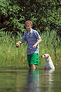 Teenage Boy Training Labrador Retriever