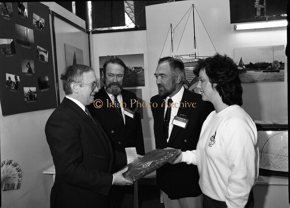 The 1989 Boat Show.   (R89)..1989..10.03.1989..03.10.1989..10th March 1989..Pat the Cope GallagherTD, Minister for the Marine attended the opening of the 1989 Boat Show held at the Point Depot, Dublin. The opening coincided with the minister's birthday...Image shows the Minister Pat the Cope Gallagher being presented with a jumper at the Boat Show in the Point Depot,Dublin.
