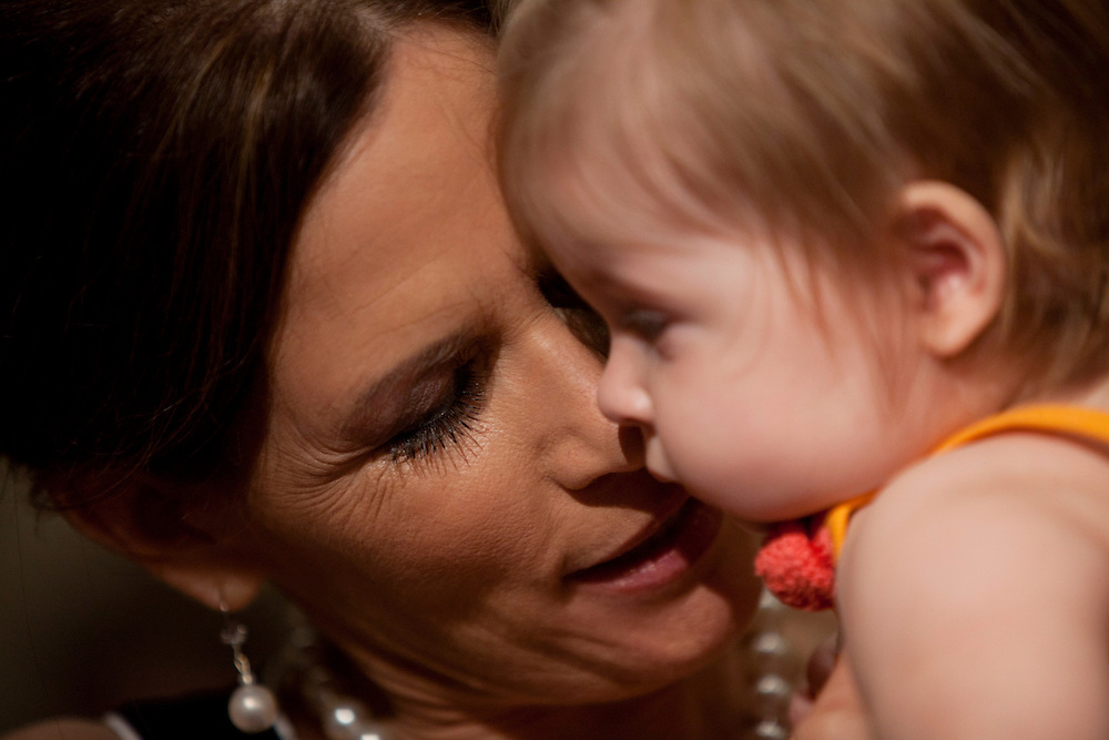 Republican presidential hopeful Michele Bachmann holds a baby during a campaign stop at New Life church on Sunday, July 24, 2011 in Marion, IA.
