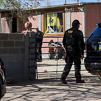 040115       Cable Hoover<br /> <br /> McKinley County Sheriff's officers secure the perimeter of a home in Gamerco during a drug raid Wednesday.