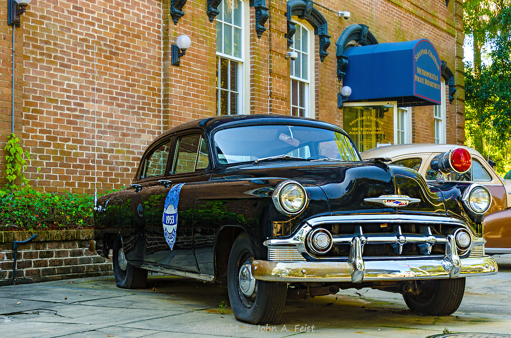 One of the great things about walking around Savannah is that you never know what is around the next corner.  We came across a group of vintage police cars on display in front of a police station.