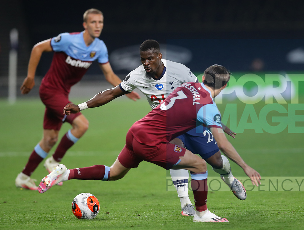Steven Bergwijn of Tottenham  skips past Aaron Cresswell of West Ham United during the Premier League match at the Tottenham Hotspur Stadium, London. Picture date: 23rd June 2020. Picture credit should read: David Klein/Sportimage