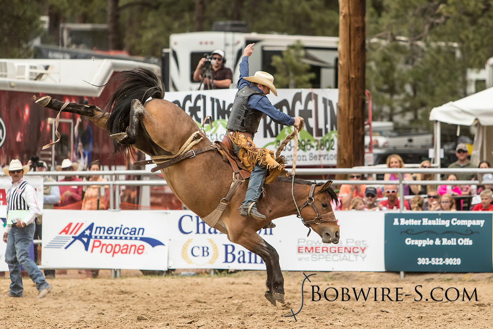 Saddle brond rider Joey Sonnier rides Summit Pro Rodeo's Hay Fever during the third performance of the Elizabeth Stampede on Sunday, June 3, 2018.
