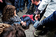 ITALY, GIUGLIANO : A women lays injured on the ground after clashes between riot police and demonstrators outside the Taverna del Re dump in Giugliano on November 2, 2010. Demonstrators protest against the re-opening of the Taverna del Re dump taht contains more than six milion tons of garbage. AFP PHOTO / ROBERTO SALOMONE