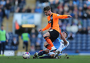 Joe Bennett, Brighton defender and Adam Henley, Blackburn Rovers defender during the Sky Bet Championship match between Blackburn Rovers and Brighton and Hove Albion at Ewood Park, Blackburn, England on 21 March 2015.