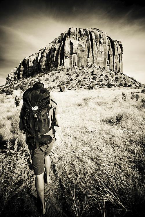 Climbers approach Supercrack Buttress, Indian Creek, Utah