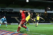 Rhys Healey of Milton Keynes Dons (10) crosses the ball past John-Joe O'Toole of Burton Albion (21) during the The FA Cup third round replay match between Burton Albion and Milton Keynes Dons at the Pirelli Stadium, Burton upon Trent, England on 14 January 2020.