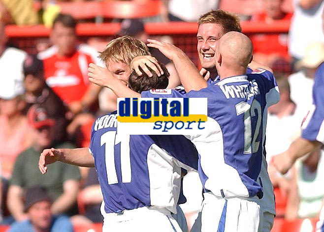 Fotball<br /> 07.08.2004<br /> Foto: SBI/Digitalsport<br /> NORWAY ONLY<br /> <br /> Date: 07/08/2004.<br /> Coca Cola League Two <br /> Leyton Orient V Macclesfield Town 07/08/2004<br /> <br /> Macclesfield Town's Jon Parkin (facing) celebrates his second goal with team mates