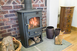 Wood burning fire at Eco House at The Wintles; Bishop's Castle,