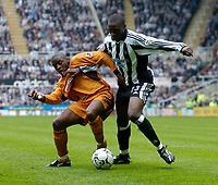 Photo. Glyn Thomas.<br /> Newcastle United v Wolverhampton Wanderers. <br /> FA Barclaycard Premiership. 09/05/2004.<br /> Newcastle's Shola Ameobi (R) battles for the ball with Shaun Newton.