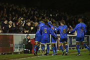 Wimbledon celebrate their equaliser with the fans during the FA Youth Cup match between U18 AFC Wimbledon and U18 Chelsea at the Cherry Red Records Stadium, Kingston, England on 9 February 2016. Photo by Michael Hulf.
