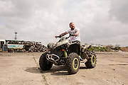 Dinko Valev poses on his ATV 4x4 around his junkyard in Yambol, Bulgaria. <br /> <br /> Matt Lutton / Boreal Collective for VICE