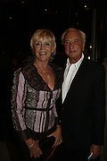 MICHAEL WINNER and GERALDINE LYNTON-EDWARDS, Dirty Dancing ,premiere: Aldwych Theatre, 49 Aldwych, London, WC2,24 October 2006. -DO NOT ARCHIVE-© Copyright Photograph by Dafydd Jones 66 Stockwell Park Rd. London SW9 0DA Tel 020 7733 0108 www.dafjones.com