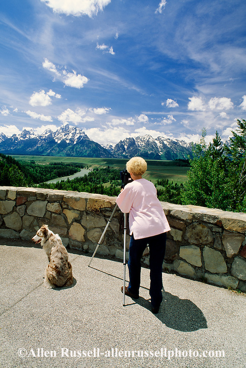 Woman photographer, Australian Shepherd, Teton Range, Grand Teton National Park, Snake River, Wyoming<br /> MODEL RELEASED<br /> PROPERTY RELEASED