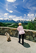Woman photographer, Australian Shepherd, Teton Range, Grand Teton National Park, Snake River, Wyoming<br /> MODEL RELEASED<br /> PROPERTY RELEASED