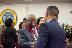 Governor Kenneth E. Mapp shakes hands with Senator Samuel Sanes.   Governor Kenneth E. Mapp enters the chambers.  Governor Kenneth E. Mapp delivers the State of the Territory Address at the Earle B. Otlley Legislative Chambers.  St. Thomas, USVI.  30 January 2017.  © Aisha-Zakiya Boyd