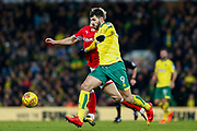 Norwich City striker Nelson Oliveira (9) sprints forward Barnsley midfielder Brad Potts (20) defending during the EFL Sky Bet Championship match between Norwich City and Barnsley at Carrow Road, Norwich, England on 18 November 2017. Photo by Phil Chaplin.
