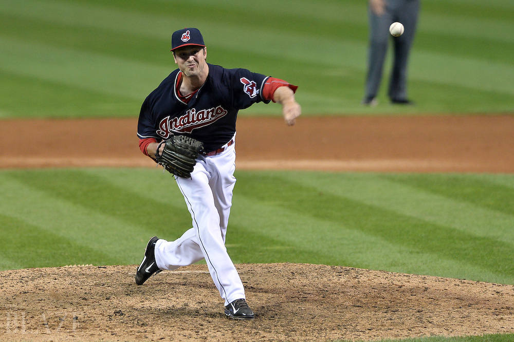 Aug 1, 2016; Cleveland, OH, USA; Cleveland Indians relief pitcher Andrew Miller (24) throws a pitch during the eighth inning against the Minnesota Twins at Progressive Field. Mandatory Credit: Ken Blaze-USA TODAY Sports