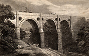 Marple aqueduct, opened 1800, over the River Goyt on the Peak Forest Canal which was constructed 1794-1805 from Whaley Bridge, Derbyshire, England, to Marple, where it joined the Macclesfield Canal. The engineer was Benjamin Outram (1764-1805), civil engineer and ironmaster, and founder of Butterley Ironworks.  The pierced spandrells lightened the weight of the masonry.  Engraving from 'The Gallery of Nature and Art' by the Rev. Edward Polehampton (London, 1815).