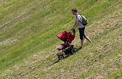 A father at Vitranc,  on June 14, 2009, at Kranjska Gora, Slovenia. (Photo by Vid Ponikvar / Sportida)