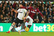 Aston Villa defender Axel Tuanzebe (4) holds off Derby County forward Jack Marriott (14) during the EFL Sky Bet Championship match between Derby County and Aston Villa at the Pride Park, Derby, England on 10 November 2018.