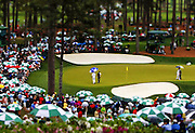 Luke Donald surveys his second shot from the bunker on No. 16 during Sunday's round of The Masters at Augusta National Golf Club in Augusta, Georgia.