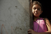 A girl stands in the doorway of her home in San Esteban, Honduras on Thursday April 25, 2013.
