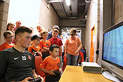 John Souttar takes on young Calum Gillan at FIFA - Dundee United open day at Tannadice<br /> <br />  - Pictures © David Young