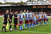 Teams shake hands before the Sky Bet League 1 match between Scunthorpe United and Shrewsbury Town at Glanford Park, Scunthorpe, England on 17 October 2015. Photo by Ian Lyall.