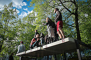 "01/05/2015 – Berlin, Germany: A group of people hangout on top of a bus stop in Kreuzberg during the ""Myfest"" street festival. ""Myfest"" takes place in district SO 36, the traditional centre of riots that usually occur during May Day celebrations and it was organized to decreased the violence caused by Revolutionary May Day Demonstrations.  The radical left wing criticises such events claiming that it is pretended to pacify social conflicts and to ban radical demonstrations. The International Workers Day is a celebration of laborers and the working classes that is promoted by the international labor movement, anarchists, socialists, and communists and occurs every year on May Day. (Eduardo Leal)"