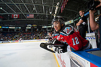 KELOWNA, CANADA - DECEMBER 6: Tyrell Goulbourne #12 of Kelowna Rockets sits on the bench against the Prince Albert Raiders on December 6, 2014 at Prospera Place in Kelowna, British Columbia, Canada.  (Photo by Marissa Baecker/Shoot the Breeze)  *** Local Caption *** Tyrell Goulbourne;