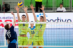 Dmitrii Bahov #17 of Moldova and Alen Sket #5 of Slovenia during volleyball match of FIVB Men's Volleyball World Championship 2014 Qualifications between National teams of Slovenia and Moldova in pool B on May 25, 2013 in Arena Stozice, Ljubljana, Slovenia. (Photo By Urban Urbanc / Sportida)