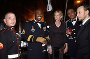 Jenna Elfman ( ?) with three members of the military wounded in the war with Iraq. Bloomberg after-party,  Russian mansion, Washington Correspondents dinner, Washington Hilton, 26 April 2003. © Copyright Photograph by Dafydd Jones 66 Stockwell Park Rd. London SW9 0DA Tel 020 7733 0108 www.dafjones.com
