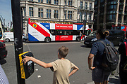 A tour bus with The Original Tour drives through Parliament Square , on 7th July 2017, in central London.