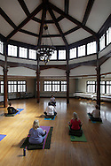 Middletown, New York - Women listen to instructor Maria Blon of Create Your Wellness, during a yoga class at the First Presbyterian Church on April 21, 2011.