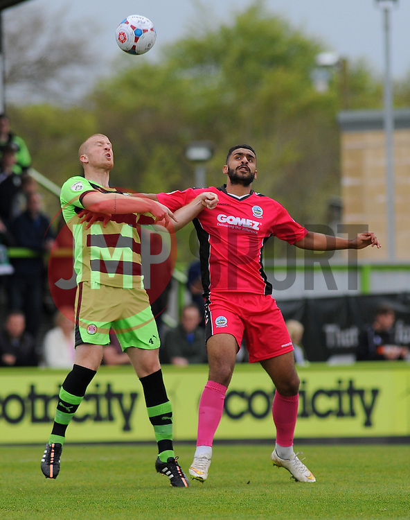 Forest Green Rovers's Charlie Clough and Dover Athletic's Joe O'Cearuill battle for the high ball.  - Photo mandatory by-line: Nizaam Jones - Mobile: 07966 386802 - 25/04/2015 - SPORT - Football - Nailsworth - The New Lawn - Forest Green Rovers v Dover - Vanarama Conference League