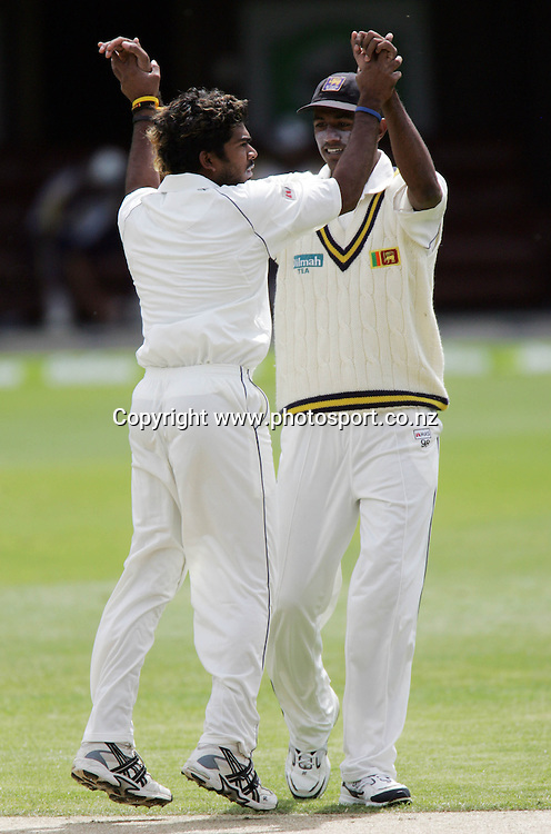 Lasith Malinga of Sri Lanka celebrates the wicket of Jamie How lbw on day one of the first cricket test match between the New Zealand Black Caps and Sri Lanka at Jade Stadium, Christchurch, New Zealand on Thursday 7 December 2006. Photo: Andrew Cornaga/PHOTOSPORT<br /> <br /> <br /> <br /> 071206