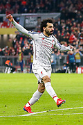 Liverpool forward Mohamed Salah (11) shoots during the Champions League match between Bayern Munich and Liverpool at the Allianz Arena, Munich, Germany, on 13 March 2019.